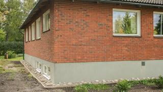 Tvätta tegelfasaden och tegelmuren