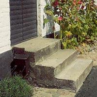 Kombination asfalt, betong och kullersten