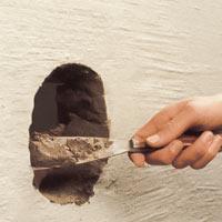 Klä hålets kanter med eldfast cement