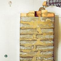 Mura skorstensanslutningen till kakelugnen med tegel