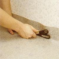 Pressa plastmattan hårt mot väggen så fatt du får en tydlig markering.