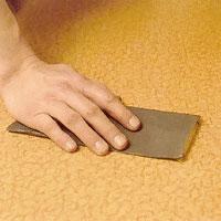 Rugga upp mattan med slippapper