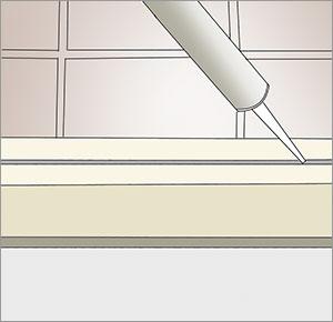 fogar silikon med fogspruta på klinkergolv