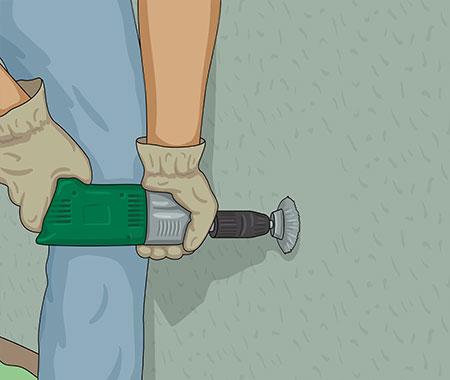 Ta bort slamfärg med stålborste på borrmaskin