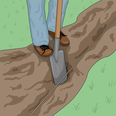 Gräver hål för staketstolpar