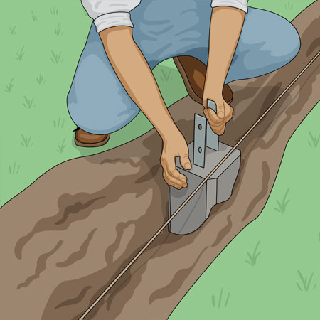 Sätter ner betongplint för staketstolpe