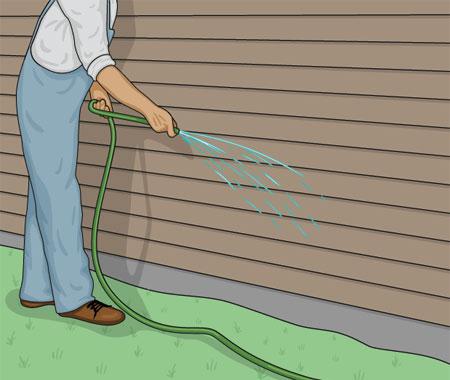 Skölj fasadytan med vatten