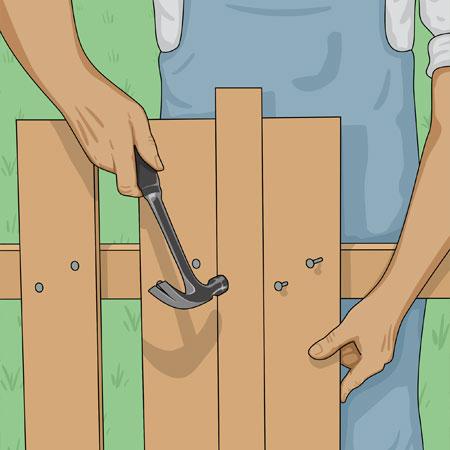 Spikar fast spjälor på staket